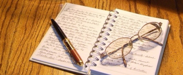 Journal and Eyeglasses