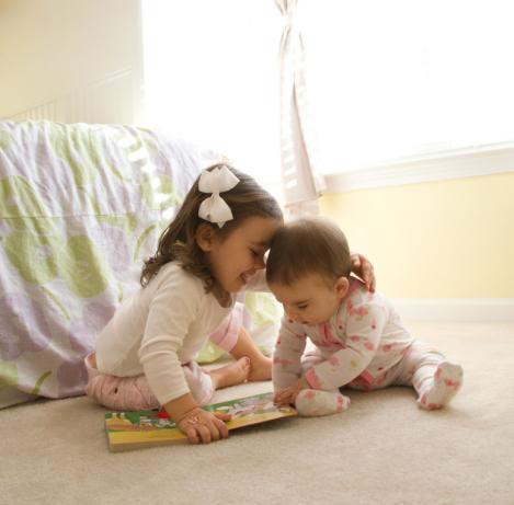 Children Sharing Book